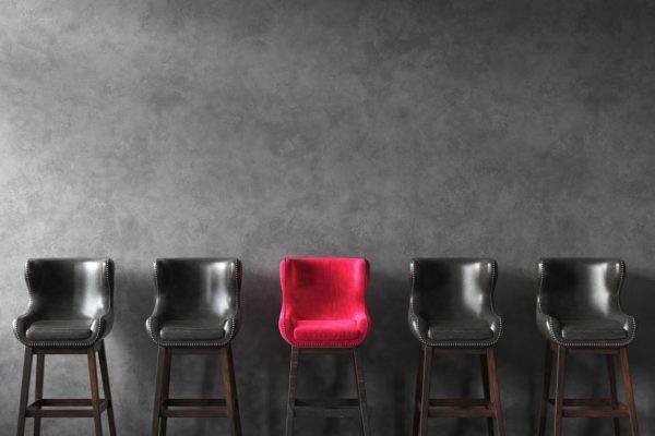 Row of chairs with outstanding pink one. Job opportunity. 3D render